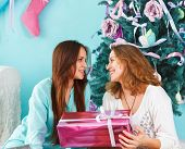 Portrait Of A Mother With Teen Daughter At Home Near The Christmas Tree