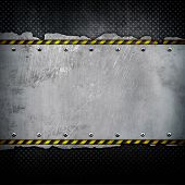 cracked metal plate with warning stripes