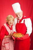 Senior couple baked a cherry pie together.