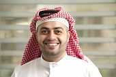Saudi Arabian young businessman standing in the office