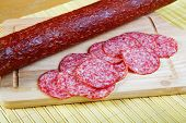 The Cut Smoked Sausage On A Wooden Board
