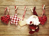 Festive Christmas decoration over wooden board background