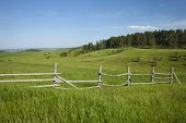 Rail Fence And Hills With Pines In Montana