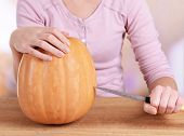 Hollowing out pumpkin to prepare halloween lantern