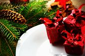Closeup Christmas Plate Red Gifts Pines Wooden Surface