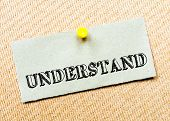 stock photo of understanding  - Recycled paper note pinned on cork board - JPG