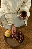 stock photo of jesus  - Jesus with bread wine and grapes on a vertical format - JPG