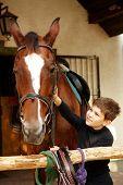 image of caress  - Cute little boy caressing horse - JPG