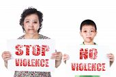 image of bruises  - Senior and kid abuse or elder and child mistreatment with a black eye bruised and injured holding Stop violence horizontal paper - JPG