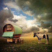stock photo of caravan  - An Old Gypsy Caravan Trailer Wagon with a Horse - JPG