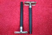 stock photo of razor  - two acute razors with steel blades on black handles - JPG