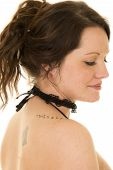 stock photo of shoulders  - A woman close up with a tattoo on her shoulder and a bare shoulder - JPG