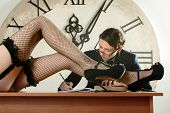 image of time study  - Sexy long legs in pantyhose in front of Man studying and take notes late at night - JPG