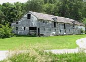 large white dilapidated barn