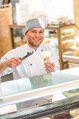 pic of confectioners  - Confectioner selling ice cream in the store - JPG
