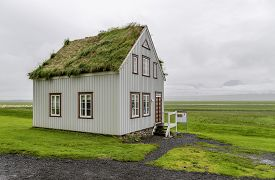 stock photo of iceland farm  - An old fashioned Icelandic house with a turf roof - JPG
