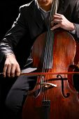 pic of cello  - Man playing on cello close up - JPG