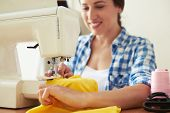 pic of sewing  - seamstress sewing yellow dress - JPG