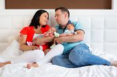 picture of twin baby girls  - Happy parents cuddling boy and girls twins - JPG