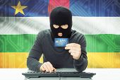 picture of african mask  - Cybercrime concept with flag on background  - JPG