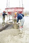 picture of concrete pouring  - concreting work - JPG