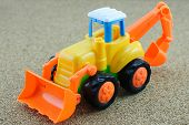 picture of backhoe  - Vintage Style Tractor Backhoe Toy on sand - JPG
