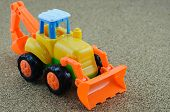 pic of backhoe  - Vintage Style Tractor Backhoe Toy on sand - JPG