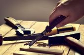 picture of pliers  - Hammer flat file pliers screwdriver monkey wrench screws board and blade on natural wooden background - JPG