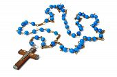 pic of prayer beads  - Rosary with blue beads on white background - JPG