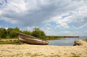 picture of old boat  - old fishing boat on the shore of the estuary beautiful nature - JPG