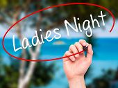 stock photo of ladies night  - Man Hand writing Ladies Night with black marker on visual screen - JPG