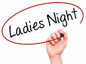 picture of ladies night  - Man Hand writing Ladies Night with black marker on visual screen - JPG