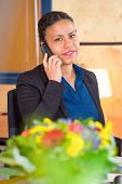 picture of receptionist  - Young receptionist of a large cooperation taking calls on a phone - JPG