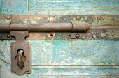 picture of bolts  - Close up of old window bolt on wooden background (wooden, window, bolt) ** Note: Visible grain at 100%, best at smaller sizes - JPG