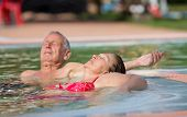 picture of hot couple  - Senior couple enjoying sun and holiday in the pool with hot water - JPG