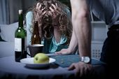 stock photo of scared  - Drunk aggressive husband and his scared wife - JPG