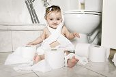 picture of disobedient  - A Toddler ripping up toilet paper in bathroom - JPG