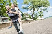 foto of time flies  - A Father and daughter having fun time outside - JPG