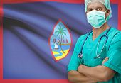 picture of guam  - Surgeon with flag on background conceptual series  - JPG