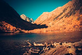 foto of mountain-high  - Scenery of high mountain with lake and high peak on a clear day - JPG