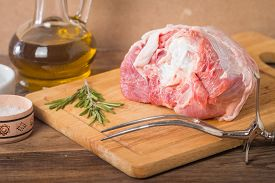 pic of turkey-hen  - Raw turkey thigh with spices on a wooden background - JPG