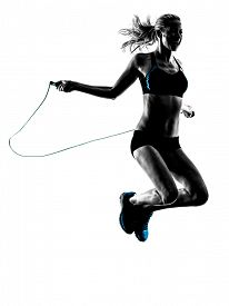 stock photo of roping  - one caucasian woman Jumping Rope exercises  in studio silhouette isolated on white background - JPG