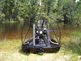 foto of airboat  - airboat parked on marsh bank cooling off and pointing in the marsh - JPG