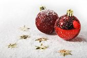Red christmas balls on snow
