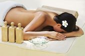 image of black woman spa  - Beautiful woman getting spa treatment at daylight outdoor - JPG