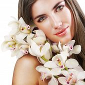 stock photo of beautiful face  - Woman with beautiful makeup and white orchids - JPG