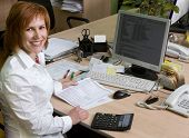 stock photo of computer-screen  - Woman leading specialist at her work place - JPG
