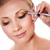 Makeup artist applying yellow eyeshadow
