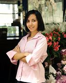 small business owner: proud woman and her flower shop