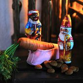 Sinterklaas and black piet by the filled shoe